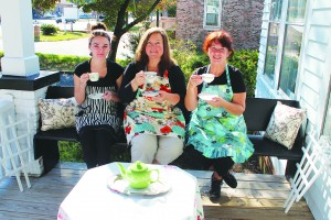 Owner Linda Pukenas (center) and full-time employees Kieri Cross (left) and Lesley Ann Bennett (right) run the Southport Tea House Tuesday through Saturday, 10 a.m. to 5 p.m.  Photo by Bethany Turner