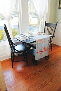 This antique tea cart, turned into a table for two, is where Linda Pukenas' love story with the Southport Tea House began. Photo by Bethany Turner