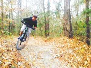 Gene Areno mountain bikes in the trails of Brunswick Nature Park, and along with dietary changes, it's helped him lose 38 pounds so far. Courtesy photo