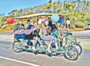 Missy Ronquillo (front), owner of Pescado Y Amor, and friends participate in last year's Oak Island Mardi Gras by the Sea Festival parade. Courtesy photo