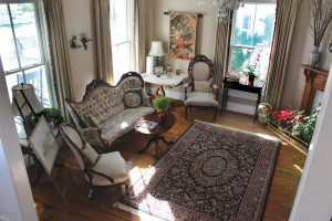 Formal sitting room, featuring Victorian furniture from the current owner's great aunt. Photo by Bethany Turner