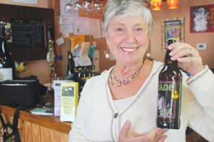 Candace Hobbs, showcasing the Jade IPA by Foothills Brewing Company, is the owner of The Grape & Ale (8521 E. Oak Island Dr., Oak Island) and a contributor to Southport Magazine. Photo by Kris Beasley