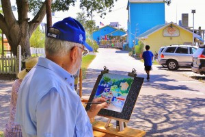 Jim McIntosh painting 'Eatery Row' at last September's Plein Air Paint Out. Courtesy photo