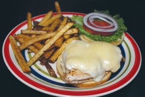 The Cape Fear chicken sandwich is smothered with crab dip and melted provolone cheese, served with hand-cut French fries.