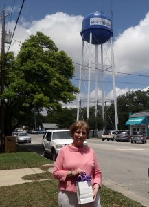 Barbara Gray, winner of $180 of gift certificates in front of the water tower. Courtesy photo
