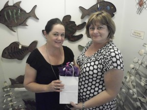 Laurie Driver (owner of Magnolia Gifts and Antiques) and Pam Reade, winner of $180 gift certificate raffle. Courtesy photo