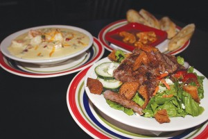 The Black and Bleu Salad features blackened steak on a bed of mixed greens, topped with veggies and bleu cheese crumbles (guests can opt for Vermont white cheddar). Try it with the red-wine vinaigrette, made fresh in-house.
