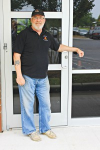 Noah Goldman, CEO and brewmaster of Check Six Brewing Company, stands in front of the door of what will be Southport's first local brewery, located at 5130 Southport-Supply Road SE.