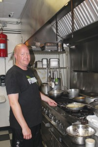 Stuart Sanders, Oasis' chef, favors the Voodoo Shrimp and the shrimp and grits dishes.