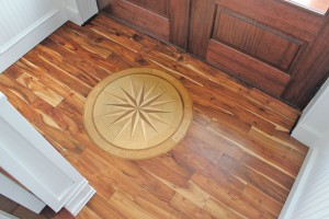 Inlaid wood presents a compass set to point exactly north in the foyer. Photo by Bethany Turner