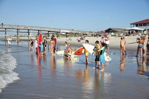 Surfer kids, ages 9 and under, prepare for the 'Guppies' heat during a past Oak Island Labor Day Surf Off. Photo by Jeff King