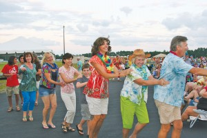 Folks dance the conga line during last year's Phlock to the Beach outdoor concert. Courtesy photo