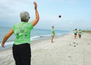 A contestant participates in the 2013 Phlock to the Beach bocce ball tournament. Courtesy photo