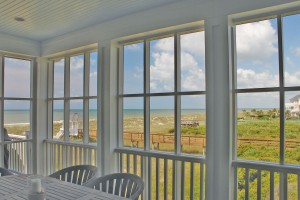 The screened porch uses screen that is very fine, so that it appears like a plane of glass. Photo by Bethany Turner