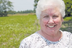 June Beasley, Southport's resident 'veggie snob,' stands in the fields of the family farm she grew up on in Loris, South Carolina. Photo by Kris Beasley