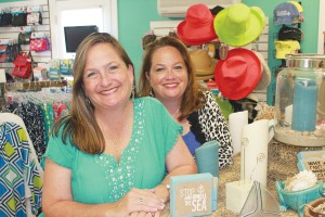 Paige Brown (left) and Melaney Robbins pose inside Color Me Carolina, an Oak Island shop for cute décor and more. Photo by Kris Beasley