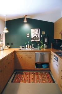 The kitchen features 1950s cabinets she located in Missouri. Photo by Bethany Turner