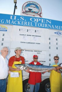 John E. Lewis (far left), aboard Second Chanze of Morehead City, NC, caught the first-place-winning king mackerel in the 2013 tournament. His fish weighed 47.05 pounds, and Lewis took home $25,000 plus a copper trophy. Courtesy photo