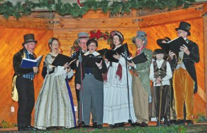 Oakwood Waits carolers from Raleigh, NC, perform at the 2013 Charles Dickens Christmas Festival. Photo by Frank Aaron