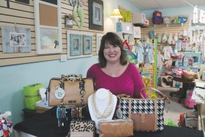 Penny Watkins founded Boo & Roo's in Southport because she loves working in retail and getting to know her customers as friends. Photo by Kris Beasley