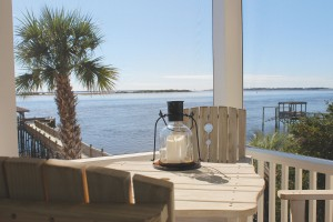 The screened porch off the main living area offers a view off the Atlantic Ocean, Cape Fear River, and Intracoastal Waterway as they collide in front of Southport. Photo by Bethany Turner