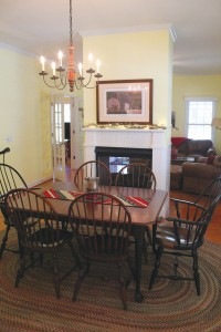 Dining room with freestanding fireplace. Photo by Bethany Turner