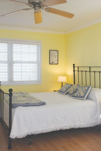 The bedroom in the guest suite is spacious and airy. Photo by Bethany Turner