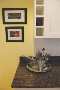 The kitchen's custom cabinetry offers space for wine bottles. Photo by Bethany Turner