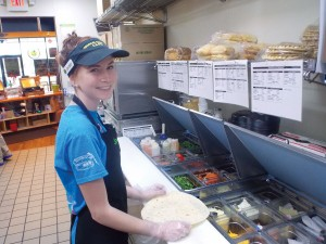 Employee Jordan Anderson prepares a flatbread sandwich at Tropical Smoothie Café. Photos by Rebecca Jones