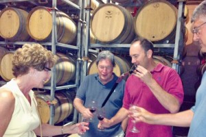 Southport residents Nancy Neidig, Joaquin Carbonell and Bob Neidig join Winemaker Carl Wicka (red shirt) of Turley Wine Cellars in a barrel tasting. Photo by Amanda Carbonell