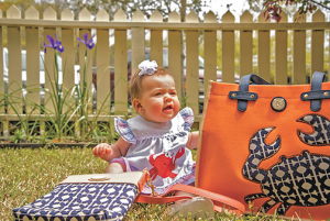 baby with bags